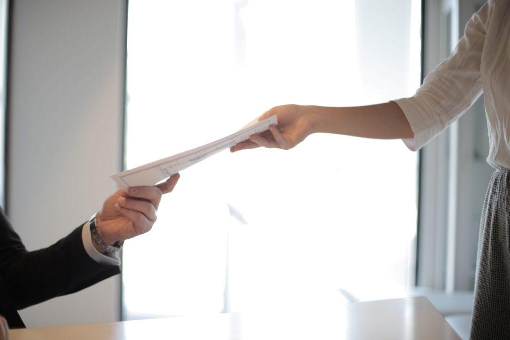 boss-handing-document-to-employee