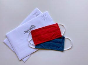red and blue masks ballots