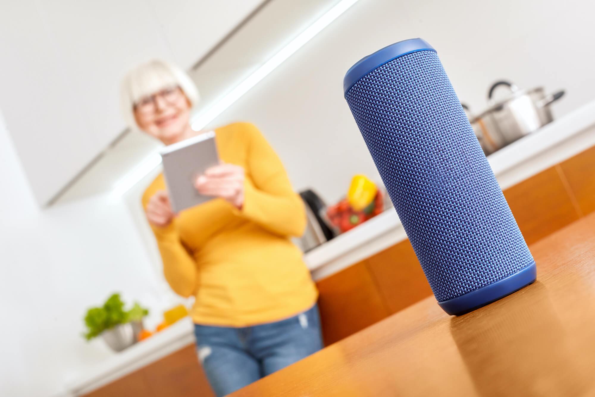 mature-woman-smart-speaker-kitchen-yellow-shutterstock_1707515707 (1)